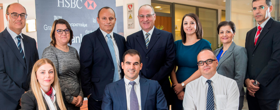 HSBC Malta's International Subsidiary Banking team led by Nicholas Elias (seated, middle) together with Michel Cordina (standing, middle)